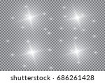 set of white glowing lights... | Shutterstock .eps vector #686261428