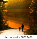 Father And Son Walking In The...