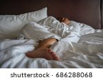 woman laying on bed in morning... | Shutterstock . vector #686288068