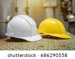 white and yellow hard safety... | Shutterstock . vector #686290558