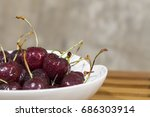 sweet cherry on a plate on...   Shutterstock . vector #686303914