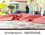 empty wooden table with red... | Shutterstock . vector #686306068