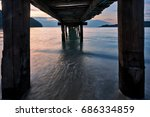 sunset over the sea. pier on... | Shutterstock . vector #686334859