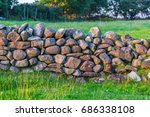 stone wall and green fields  in ... | Shutterstock . vector #686338108