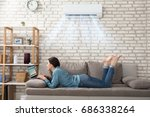woman lying on sofa using... | Shutterstock . vector #686338264