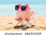 pink piggy bank with sunglasses ... | Shutterstock . vector #686341039