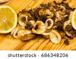 fried squids and shipirons ...   Shutterstock . vector #686348206
