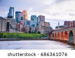 Stock photo downtown minneapolis minnesota at night time as seen from the famous stone arch bridge 686361076