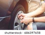 close up hand man car parking a ... | Shutterstock . vector #686397658