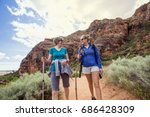 two happy women hiking together ... | Shutterstock . vector #686428309