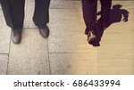 Small photo of Concepts of continue or quit; stay or walk away; stop or go. Man is standing and walking away; taken from knees down; wearing black trousers and brown shoes. Retro style. Bottom copy space for text.
