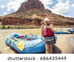beautiful woman on a rafting... | Shutterstock . vector #686435449