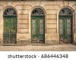 old villa with three tall doors ... | Shutterstock . vector #686446348