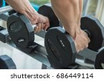 two hand of sport man is... | Shutterstock . vector #686449114