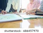 business team meeting present... | Shutterstock . vector #686457970