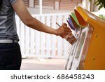 put trash in trash by the... | Shutterstock . vector #686458243