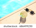 tasty refreshing cocktail with... | Shutterstock . vector #686499250