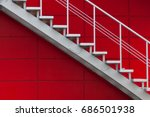 Gray Metal Stair On The Red...