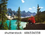 hiker enjoying the view of... | Shutterstock . vector #686536558