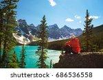 hiker enjoying the view of...   Shutterstock . vector #686536558
