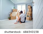 young couple on the floor in a... | Shutterstock . vector #686543158