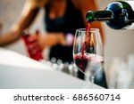 pouring red wine | Shutterstock . vector #686560714