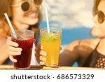 beautiful young women clinking...   Shutterstock . vector #686573329