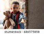 cute little boy with piece of... | Shutterstock . vector #686575858