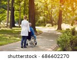 hospice nurse helping elderly... | Shutterstock . vector #686602270