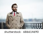 pensive young man in beige... | Shutterstock . vector #686614690