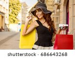 young woman shopping outdoor | Shutterstock . vector #686643268
