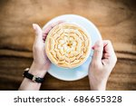 holding hot cup of coffee with... | Shutterstock . vector #686655328