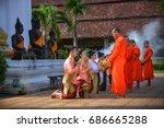 religious activities of lao men ... | Shutterstock . vector #686665288