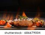 grilled pork steak with... | Shutterstock . vector #686679004