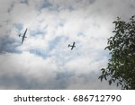 Small photo of a glider hauled by plane over the trees