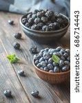 bowls of blackberries and... | Shutterstock . vector #686714443