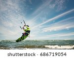 a kite surfer rides the waves | Shutterstock . vector #686719054