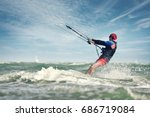 a kite surfer rides the waves | Shutterstock . vector #686719084