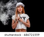 young beautiful woman is vaping ... | Shutterstock . vector #686721559