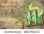 sandwich with smoked sprats in... | Shutterstock . vector #686758213