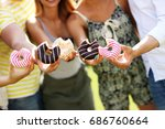 group of friends eating donuts... | Shutterstock . vector #686760664