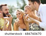 group of friends eating donuts... | Shutterstock . vector #686760670