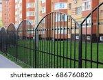 black metal fence in front of... | Shutterstock . vector #686760820