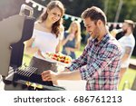 friends having barbecue party... | Shutterstock . vector #686761213