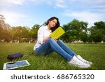 young woman reading a book and... | Shutterstock . vector #686765320