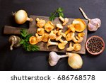 fresh chanterelle mushrooms... | Shutterstock . vector #686768578