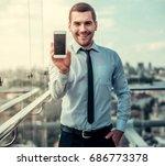 handsome businessman is showing ... | Shutterstock . vector #686773378