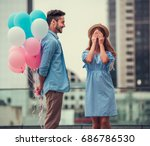 romantic couple walking in the... | Shutterstock . vector #686786530