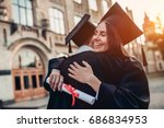 Graduates In Mantles With...