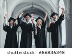 happy graduates are standing in ... | Shutterstock . vector #686836348